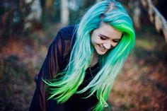 Blue-green hair. Vibrant neon colors. The fading is pretty on this.