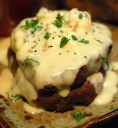 """Fillet with Gorgonzola Sauce ~ This creamy rich Gorgonzola Sauce is made by combining Heavy Cream, Crumbly Gorgonzola (not creamy or """"dolce""""), Freshly grated Parmesan, Salt and freshly ground black pepper  with minced fresh Parsley. Poured on top of a sizzling rare fillet and then sprinkled with more Gorgonzola pieces."""