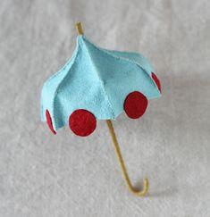 Make It : Spring Forward with Cynthia Treen Miniature Felt Umbrella Tutorial, via Martha Stewart.