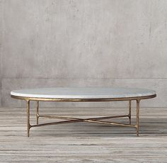 Thaddeus Forged Brass & Marble Round Coffee Table RH's Thaddeus Forged Brass & Marble Round Coffee Table:Inspired by the sculptural designs of Diego Giacometti, our collection from Julie Lawrence merges the rustic sensibility of hand-forged metal with coo Brass Coffee Table, Round Coffee Table, Coffee Table Design, Modern Coffee Tables, Design Table, Table Designs, Forging Metal, Metal Bar, Rug Sale
