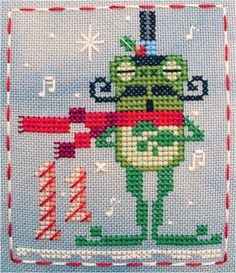 It's Fitzwilliam Frog - #11 of 25 Brooke's Books Advent Animals cross stitch freebie designs by Brooke Nolan. http://www.craftsy.com/user/1333992/pattern-store?_ct=fhevybu-ikrdql-fqjjuhdijehu