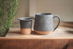 Wheel thrown mug & loose leaf tea infuser set. Glazed in Matte Charcoal over a speckled clay body. Set Includes mug and matching loose tea...