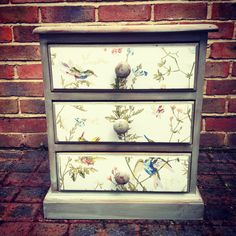 Shabby Chic Bedside Cabinet via Etsy with Cole & |Son humming bird wallpaper on drawers. Lovely for a little girl's room!