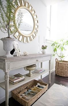 Entryway solution. Sunburst mirror just like mine. Narrow white/gray washed entry table.  Clean. Chalk paint look.