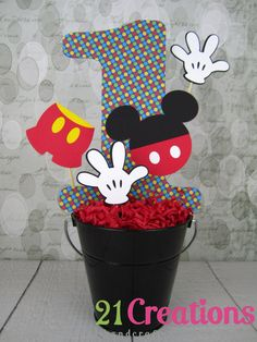 Mickey Mouse Centerpiece: cute, but use something like pooh or zoo animals instead of harsh reds.