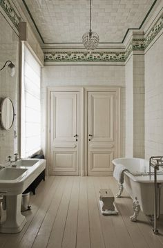 Elegant neutral color classical bath, claw foot tub, marble ceiling, old world charm