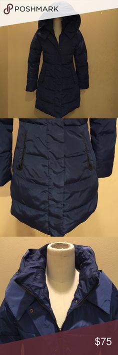 Long puffer jacket. New and never been worn. Navy blue fitted long puffer hooded jacket great for the winter. It zips up and snaps closed as well. Deep front useable pockets and navy fabric on the inside wrist to give extra warmth and protection from weather. Jackets & Coats Puffers