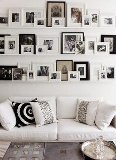 Picture Shelves - Narrow shelves with lip to prevent pictures from slipping forward. This is a much better idea than hanging them individually on the wall.