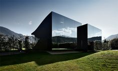 Located just outside the city of Bolzano, Italy, the Mirror Houses are a striking pair of holiday homes designed by architect Peter Pichler //