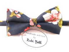 Floral Bow Tie with Grey Background and Pink, White and Green Flower Pattern. Floral Bow Tie with Grey Background and Pink, White and Green Flower Pattern, Wedding Bow Tie, Man Bow Tie, Mens Bow Tie >>> Size of the bow - Width: 6 cm / 2,36 inches - Length: 12 cm / 4,72 inches >>> Other details - Pre-tied, attached to an adjustable strap (one size fits all) - Material: Cotton - Care: Dry clean - Comes packaged in a box with logo. NOTE: Flower arrangement on each bow tie may vary and differ...