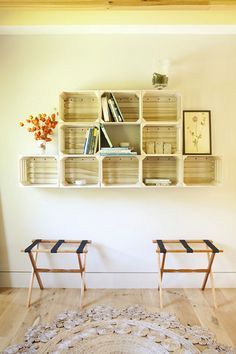 Wine crates as wall shelving.