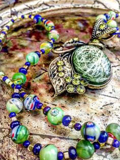 Bohemian Long Beaded Necklace, Beautiful large Pendant Antique Look. Lampwork Rondelle Glass Beads in Green, Blue and Red. Crystal Blue Bead by GitanaYoSoy on Etsy
