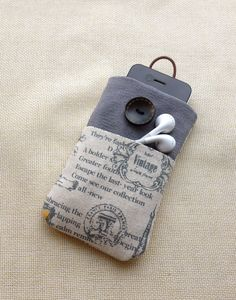 Vintage Paris style handmade fabric iPhone sleeve, iPod touch case,Kindle case,smart cellphone cover, tablet  cover, pouch. $12,99, via Etsy.
