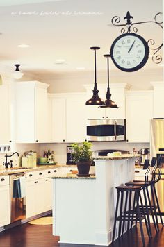 Like this kitchen with white cabinets and dark fixtures | A Bowl Full of Lemons