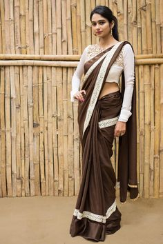 A stunner in a simply chic and sophisticated chocolate brown crepe! Yards of pure crepe material which drapes like a dream, having a wide satin border with a surprise lace edging in pearl and stone. A truly complimenting saree this…A blouse in beige or off-white to compliment the lace or a even a blouse in black to make it alternate. Oh…how about a shimmer blouse for some chic styling? Pair away! #houseofblouse #saree #blouse #indianwear #india #fashion #bollywood #brown #satin #crepe #lace
