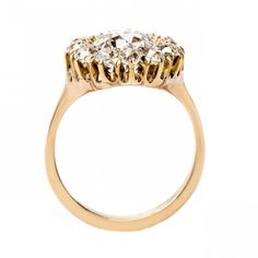 New Bond Street is an incredible Victorian era yellow gold cluster ring centering a EGL certified Old European Cut diamond. Hexagon Engagement Ring, Engagement Rings, Bond Street, European Cut Diamonds, Diamond Cluster Ring, Diamond Cuts, Victorian, Gold, Jewelry