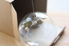 bubble chandelier diy | Tie fishing line through the wire loop, and push it into the hole ...