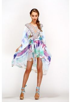 Camilla 2013 - DREAM MERCHANT SHORT BELTED KAFTAN W/ ARM DETAIL US$522.00 SKU: SS300195DRE DETAILS This loose fit Short Belted Kaftan features a V neckline with Swarovski Crystals, belt detail to create gathering in the front and a winged effect arm detail. This is a sheer garment and may require a slip. The perfect inbetween piece while can easily be worn day to day or as an occassion piece.