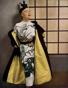 1952 - Model in Pierre Balmain novelty print painted Japanese white and black sheath. Dress and velvet coat , photo by Seeberger,