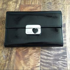 21e19d9ddb22 Black Lovcat Leather Wallet Nice shiny leather. Snap closure. Has a lot of  slots