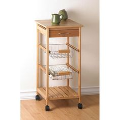 Osaka Rolling Kitchen Cart ~ Attractive rolling cart complements any gourmet kitchen! The perfect fusion of fashion and function, with a sleek tower silhouette containing a solid bamboo top, utensil drawer, two baskets and a bamboo shelf. Rolling Kitchen Cart, Kitchen Trolley, Island Kitchen, Ikea Shelves, Basket Shelves, Basket Storage, Storage Cart, Storage Ideas, Osaka