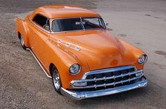 Classic orange car.