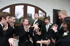 This groom and his groomsmen know how to pose for a wedding picture