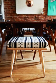 How To Make Your Place Look AWESOME #refinery29  http://www.refinery29.com/ideas-for-small-space-living#slide2  Always have a one-off.  This  stool adds playful pattern and texture to the dining area. And, since it is backless, it maintains the open layout of the space.