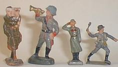 Toy soldier - Composition Figures Composition figures were made in various sizes, the first two here are 54mm by ELASTOLIN. The smaller two are by LINEOL the officer saluting is 40mm while the grenadier (painted in Danish uniform) is 30mm high