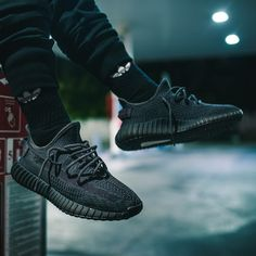 You can never have too much heat, so cop the adidas Yeezy Boost 350 V2 Black. This Yeezy Boost 350 V2 comes with a black upper, black midsole, and a black sole. These sneakers released in June 2019 and retailed for $220. Yeezy Sneakers, Yeezy Shoes, Shoes Sneakers, Winter Trends, Summer Trends, Yeezy Boost 350 Black, Yeezy 350 V2 Black, Yeezy Womens, Sneaker Shop