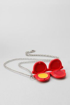 Andrea Garland Sunglasses Lip Balm Necklace. I love this and need it in my life!