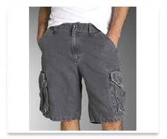 Shultz, cargo shorts, untucked shirt