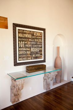 contemporary hall, LA Spanish home - Restoration Hardware console table, wall-mounted hand-carved corbels and glass shelf