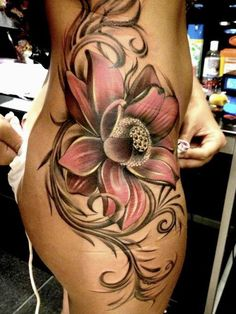 See more Stunning flower tattoo on side body