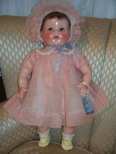 """Ideal Baby Beautiful in pink. The dolls were made with compsoition flange heads from 1945 to 1947. After 1949 the Baby Beautiful doll was made from hard plastic. This is the type of baby doll seen in the 1947 Christmas movie """"Miracle on 34th Street, with child star Natalie Wood."""