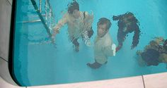 crazy installation in japan from leandro erlich.  people on the top can still dip their toes...  people on the bottom can pretend they're octopi.    sometimes life feels like this...  trapped on the wrong side of the water,  everything drunk and distorted up in the air.