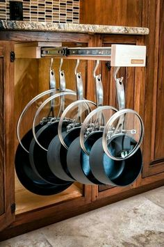 Glider for pots and pans.…love how the lids are slid over the handle...Genius!