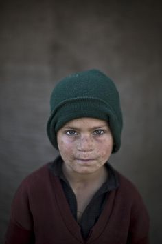 <b>Associated Press photographer Muhammed Muheisen has captured candid photos of Afghan refugee children playing in a slum on the outskirts of Islamabad, Pakistan.</b>