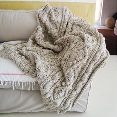 Wouldn't it be nice to cuddle up under this cable knit throw?