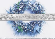 Silver Merry Christmas - Holiday Greeting Cards-The Office Gal A beautiful Christmas wreath in shades of blue with silver decorations adorn this card, a stunning silver banner runs across the front of this card stamped with the sentiment Merry Christmas.