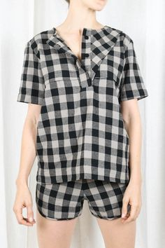 A sophisticated, short-sleeved henley top in a cozy, lumberjack plaid to elevate your flannel PJ game. The Flannel Plaid Top has button closure in the front and a modern asymmetrical collar. You'll be simultaneously comfortable and photo-ready for any holiday pic. Pair this cute top with the matching Flannel Plaid Short for the perfect plaid set. #pajamas