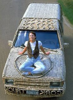 Wow. A car covered in wine corks. Now that is creative. This took 10,000 wine corks.