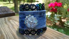 Check out this item in my Etsy shop https://www.etsy.com/listing/294025109/denim-bracelet-with-aurora-borealis