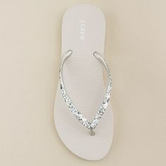 I bet you could get plain flip flops at the dollar store and glam them up!