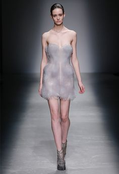 Dutch fashion designer Iris van Herpen has formed garments from a fine steel mesh burnished in swirls for her Autumn Winter 2015 ready-to-wear collection.