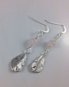 Rhodium plated feathers dangle from sweet, little, pale pink Rose Quartz rounds. Rose Quartz is the stone of unconditional love, and of the heart