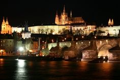 Prague Castle and the Charles Bridge at night.