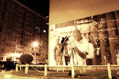 The artist took photos of inhabitants of the largest ghetto outside of Paris, then plastered them to the walls of buildings around the city. Part 2.