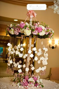 lets make a cool chandelier like this for the middle of the tent- we can use fabric instead of flowers-so pretty