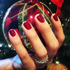 """Holiday Nails! I LOVE a deep red this time of year! My FAVORITE is @opi_products """"Got The Blues For Red"""". It's such a deep rich red! Plus it matches my tree! Haha! 😂🎄💅🏽💃🏽"""